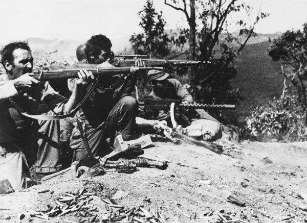 Infantrymen of the U.S. Mars Task Force unit attack Japanese troops in the Burma Road Sector, 80 miles north of Lashio