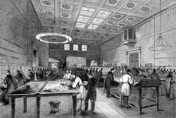 The inland letter office of the General Post Office, London showing male workers weighing, stamping and sorting letters