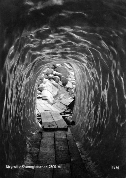 View inside the Rhone Glacier in the Swiss Alps, at a height of 2300 metres. Wooden planks have been laid down for tourists to walk on. Date: circa 1940
