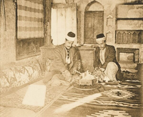 Interior in an Eastern Turkish house from Mardin, Turkey. Showing a very distinctive regional costume. Mardin is located on a rocky mountain overlooking the plains of northern Syria