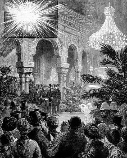 International Electric Exhibition at Crystal Palace in 1882, showing crowds of visitors viewing the great chandalier in the Alhambra Court