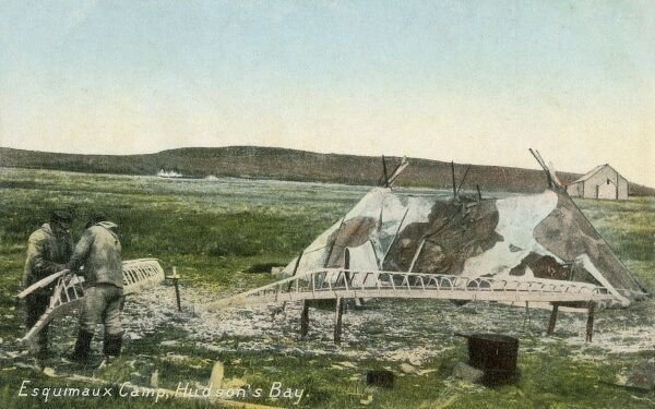 Inuit Camp at Hudson Bay in summertime. A Canoe is being built by the side of a hide-covered tent