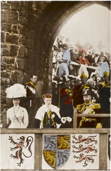 The investiture of Edward (the future King Edward VIII) as Prince of Wales, flanked by his parents, King George V and Queen Mary at Queen Eleanor's Gateway, Caernarvon Castle on 13th July 1911