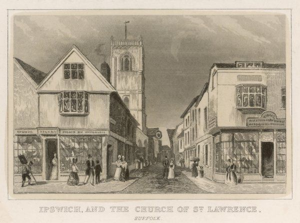 A street scene in Ipswich, Suffolk, with shops and the church of Saint Lawrence
