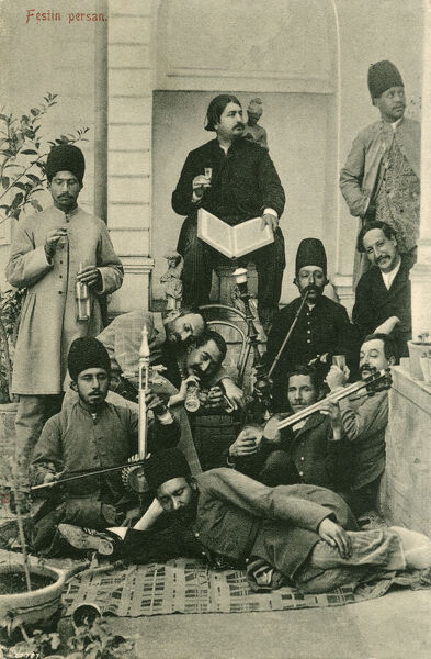 A group of Iranian men (in a variety of states of sobriety!) following a 'Festan Persan' or 'Royal Persian Feast' in Tehran, Iran. A number of the men are holding and playing musical instruments, a hubble bubble (houkah) pipe is being enjoyed