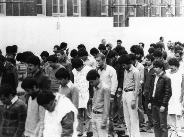 Iranian students praying and demonstrating outside the Iranian Embassy, London, during the siege. Date: 30 April - 5 May 1980