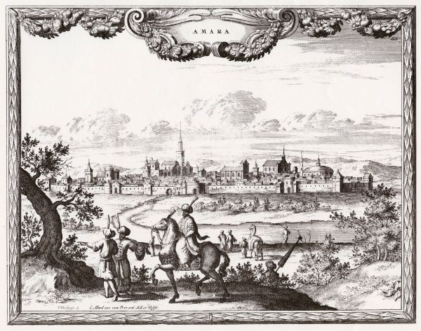 Amara: general view of the town, with travellers in the foreground