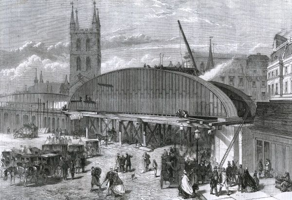 The massive iron bridge at London Bridge station, carrying the railway over the roadway and forward to Charing Cross. Date: 1863