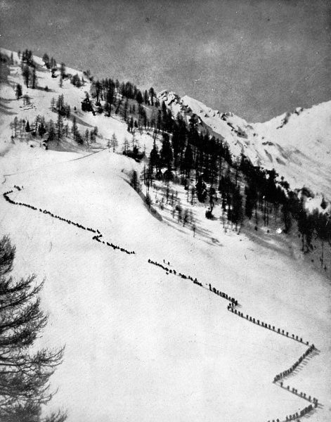 Italian Alpini troops forming a zig-zag line as they ascend Monte Adamello during their Alpine struggle against the Austrians in World War I