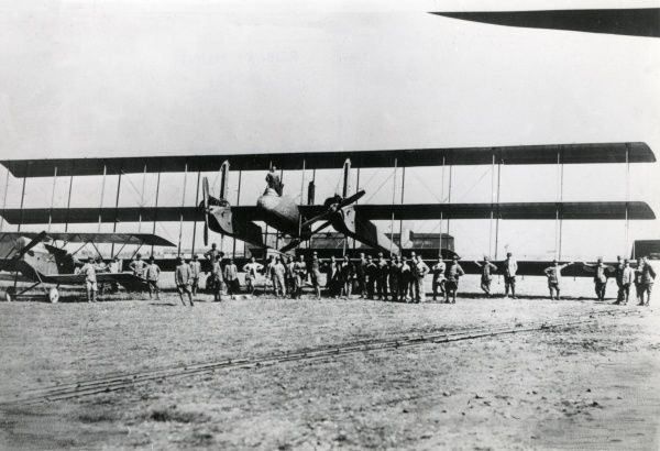 The Italian Caproni Ca.4 heavy bomber plane, used during the First World War and later. It was a three-engine twin-boom triplane constructed in wood and covered with fabric. Seen here in an airfield with various crew