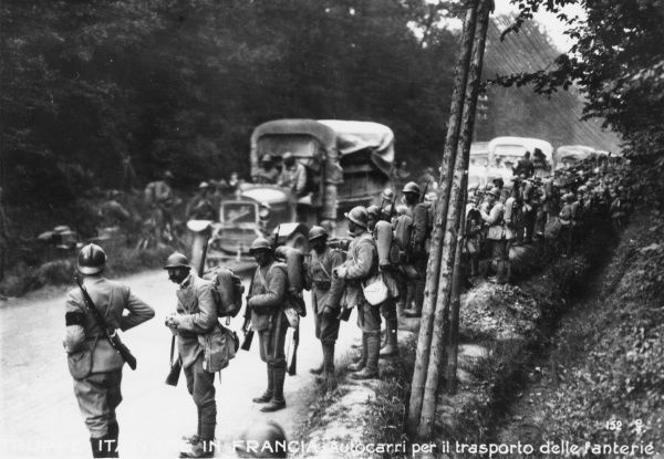 Italian infantry in France during the First World War. Showing transportation trucks and men on a road in a wood near Rheims, north eastern France. Date: June 1918