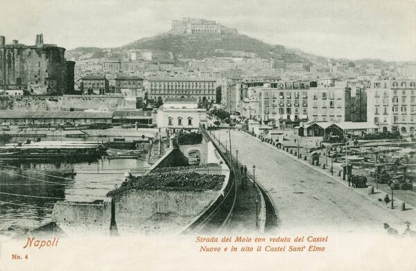 Italy - Naples - Strada del Molo (Wharf Street) with a view toward the New Castle (left) and raised in the distance, the Castle of Saint Elmo
