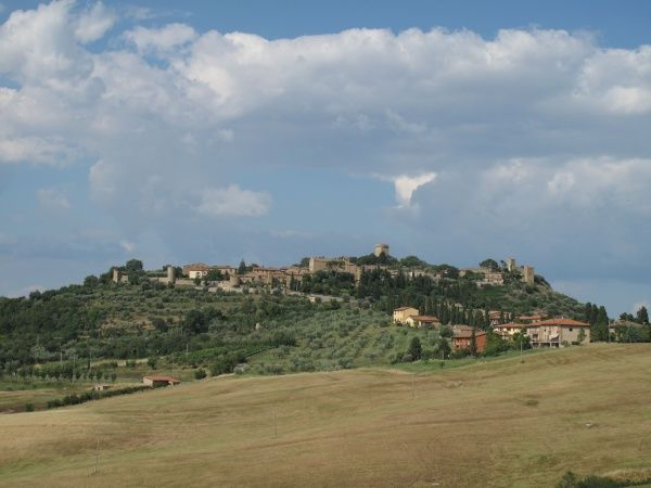 Italy, Tuscany, Province of Siena, Monticchiello: View towards village. Date: 2010