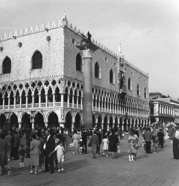 A lively scene outside the Doge's Palace, Venice, Italy. Date: late 1950s