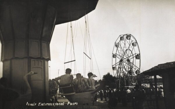 Funfair at Izmir (Smyrna), Turkey, with large ferris wheel and carousel rides