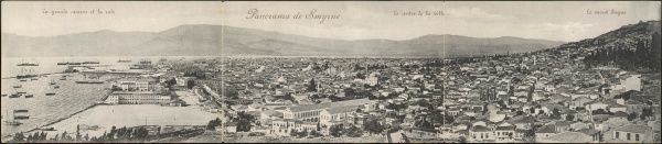 A superb fold-out panorama postcard of Izmir (Smyrna), Turkey, with ships anchored in the roads on the left