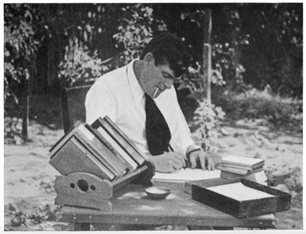 JACK LONDON American writer, in 1913 writing in his garden