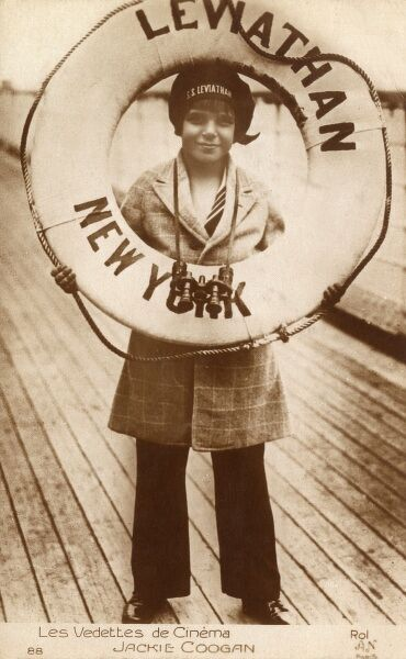 Jackie Coogan (John Leslie Coogan 1914-1984) - child star of silent films (famously starring alongside Charle Chaplin in 'The Kid'), holding up a lifebelt on the deck of the SS Leviathan (originally the SS Vaterland - siezed by the US