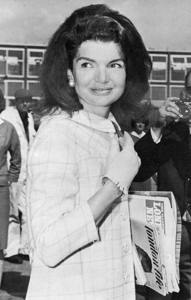 "Jacqueline Kennedy, during a visit to London in 1966 is photographed carrying a copy of ""London Life' magazine which ran for just two years between 1965 and 1966 but chronicled the life and times of swinging sixties London"