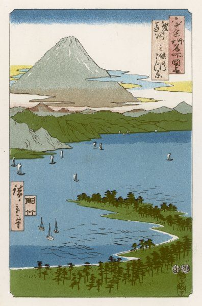 Fujiyama in the distance, with boats on the water in the foreground