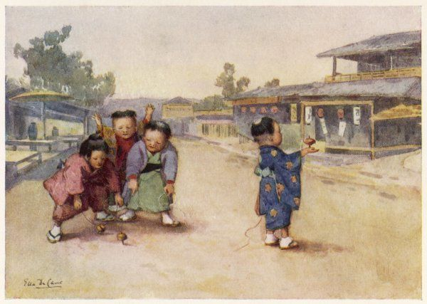 Japanese children, dressed in kimono, play with their spinning tops in the street