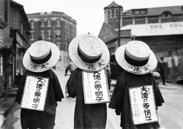 If we MUST bring back the straw hat, why not copy the Japanese method of popularising it? Three straw 'boaters', worn with advertising sandwich boards! Date: 1933