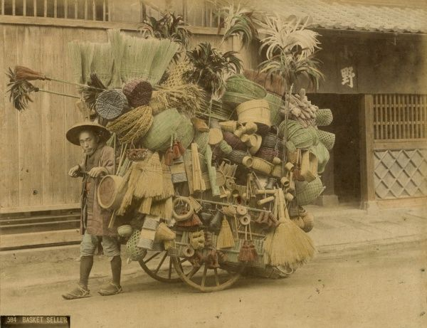 Japanese peddler with a crowded barrow Date: 19th century