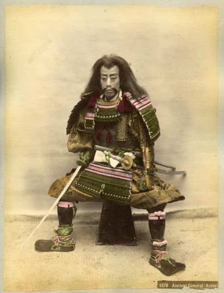 Japanese actor in the costume of a Samurai warrior