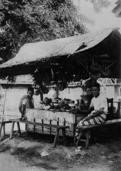 A stall selling fruit and vegetables in Java, Indonesia (Dutch East Indies). Date: 1930s