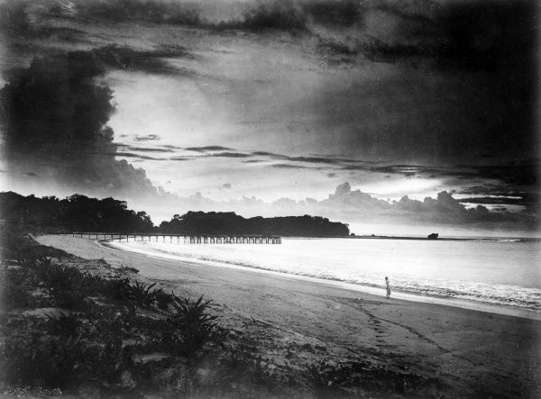 A lovely sunset off the coat of Java, Indonesia. Date: 1930s