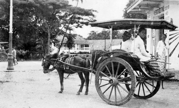 A horse-drawn taxi cab in Java, Indonesia. Date: 1930s