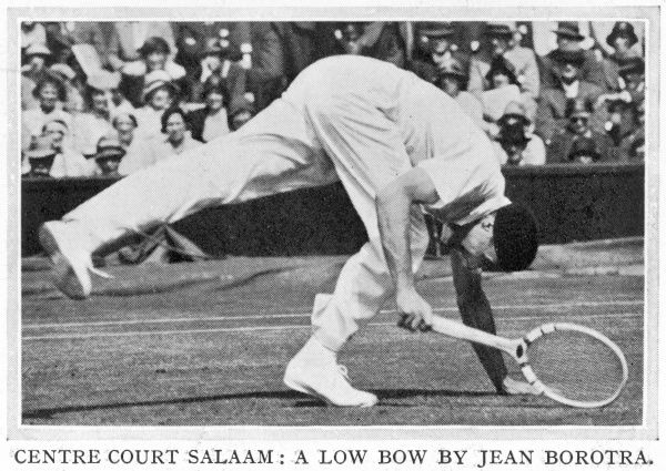 Jean Borotra (1898-1994), French tennis player known as the 'Bounding Basque', pictured here in action during a match on the Wimbledon Centre Court in 1932 wearing his signature beret