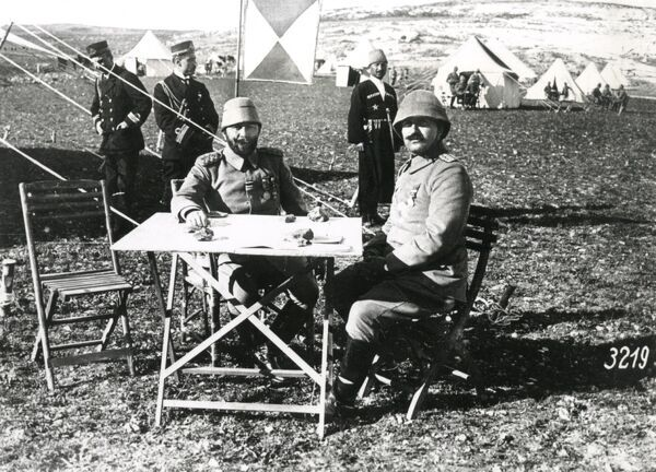 Ahmed Jemal (Djemal, Cemal) Pasha, Commander-in-Chief of the Fourth Ottoman Army, seen here with his chief of staff Fuad Bey at a battle position in Southern Palestine during the First World War. Date: circa 1918