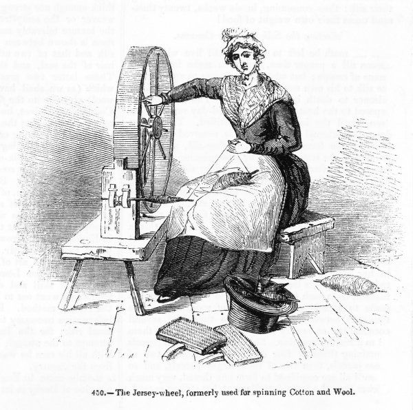 An Englishwoman using a Jersey spinning-wheel to spin wool which has been 'carded' with the cards lying at her feet