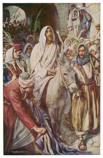 Jesus makes his entry into Jerusalem on a donkey accompanied by his followers bearing palms