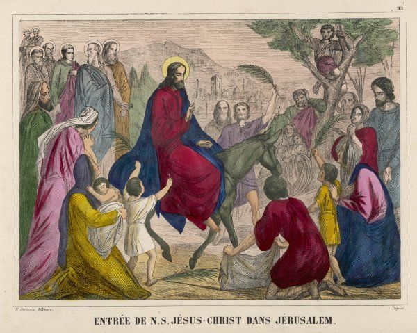 Jesus rides into Jerusalem on a donkey