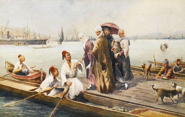 Typical scene at a typical jetty on the Golden Horn. Women are assisted into ferry boats for crossing the Golden Horn