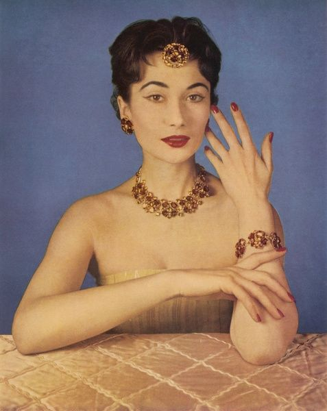 "A ""Tuileries"" topaz jewellery set by Christian Dior consisting of a necklace, bracelet and head adornment. Worn with complementing make up - lipstick and nail varnish by Lancome"