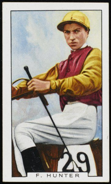 Fred Hunter, jockey, in the colours of Mr Stanley Wootton