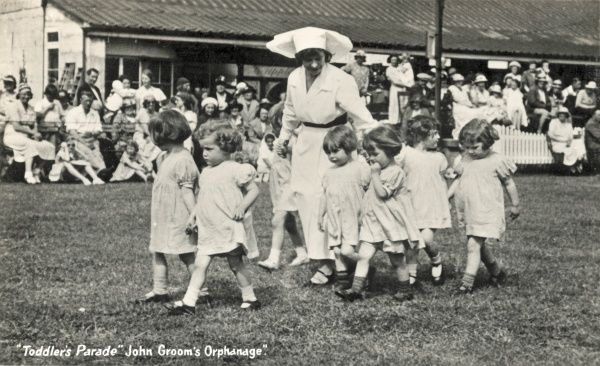 Toddlers Parade at John Groom's 'Orphanage and Crippleage', opened in 1890 at Clacton on Sea, Essex. Groom was a London engraver and evangelical preacher, whose concern for poor and often disabled flower sellers, and for deprived