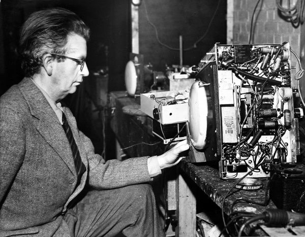 Photograph showing John Logie Baird (1888-1946), the Scottish electrical engineer and television pioneer, conducting a television experiment at his home in Sydenham Hill, London, 1942