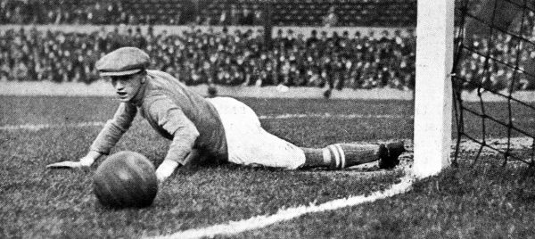 Photograph showing Johnson, the Leeds Goalkeeper, pushing a shot wide of his goal post, 1925. Although Johnson was successful this time, he could not stop (Woolwich) Arsenal beating Leeds 4-1 in this match at Highbury, London