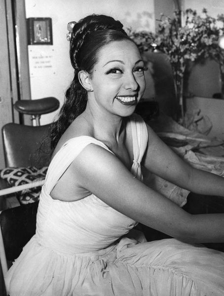 Josephine Baker (1906-1975) French singer in her dressing room at Alexandra Palace before taking part in a BBC cabaret show called Cafe Continental. She is a wearing a Schiarapelli gown that cost 1,20&quot