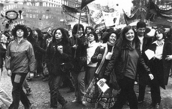 Women process through the streets of Paris, affirming their status and rights. Date: 1980