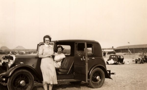 Two women parked on the beach with their Jowett 7 HP Fabric Saloon. Note the direction the door opens, contrary to the style today