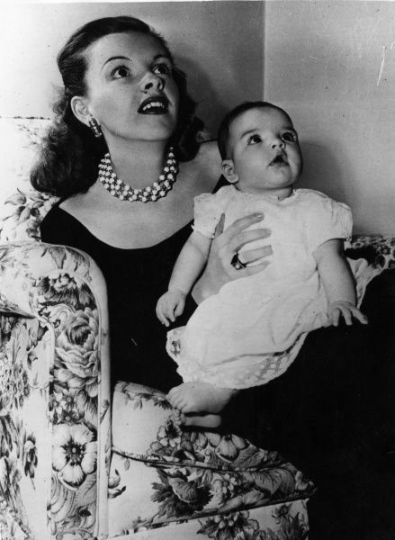 Judy Garland (1922-1969), American actress and singer with her daughter, Liza Minnelli (b. 1946)