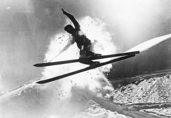 An athletic skier jumping and surfing through the snow. Date: early 1930s