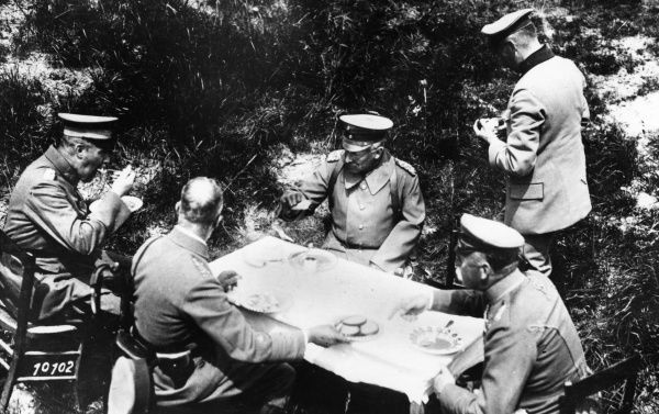 Kaiser Wilhelm II (1859-1941), German Emperor (centre), with army officers, eating lunch in the field during a visit to the Western Front, First World War. Date: June 1918