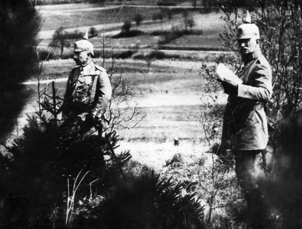 Kaiser Wilhelm II (1859-1941), German Emperor (left), with one of his army officers, observing the use of poison gas during the First World War. Date: 1915