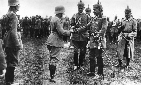 Kaiser Wilhelm II (1859-1941) presenting decorations to his soldiers during the First World War. Date: 1914-1918